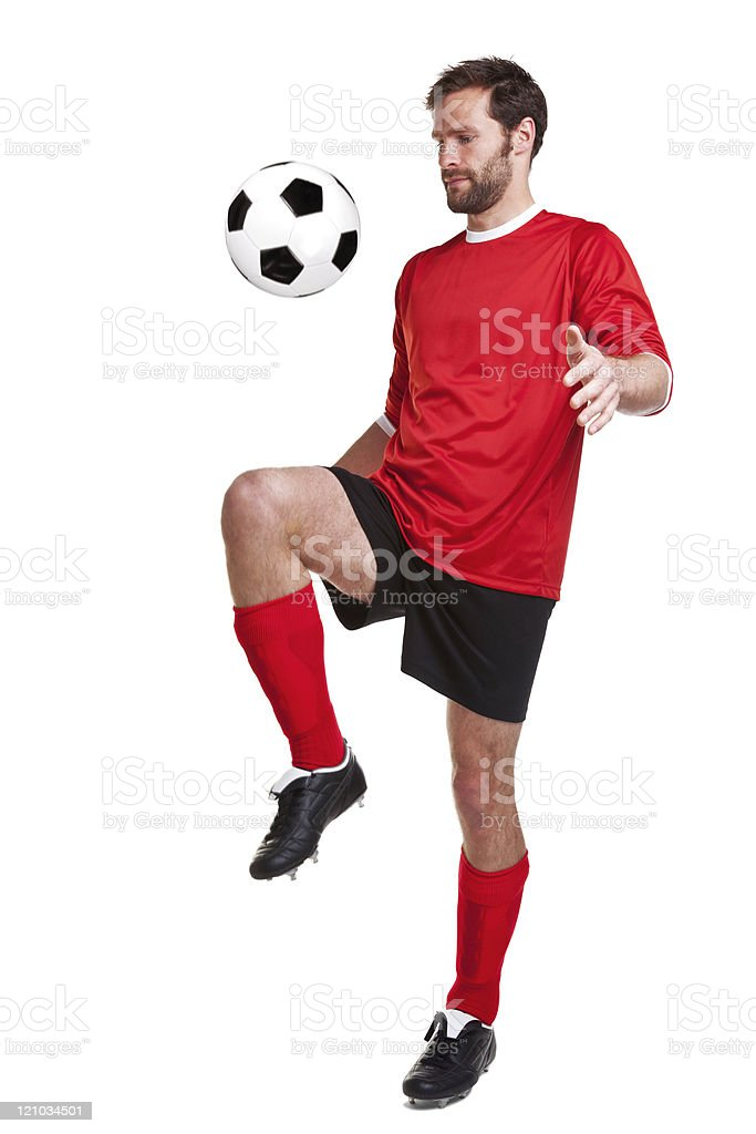 Footballer cut out on white royalty-free stock photo