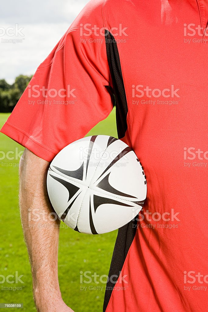 A footballer holding a ball royalty-free 스톡 사진