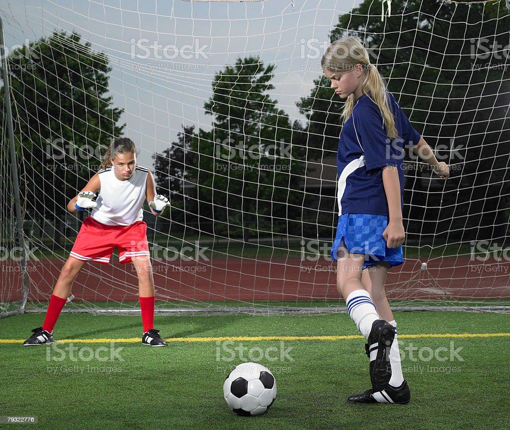 A footballer kicking a ball 免版稅 stock photo