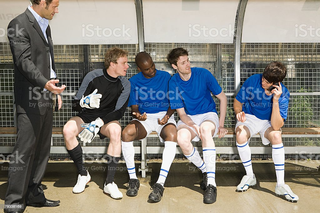 A footballer on a cell phone royalty-free 스톡 사진