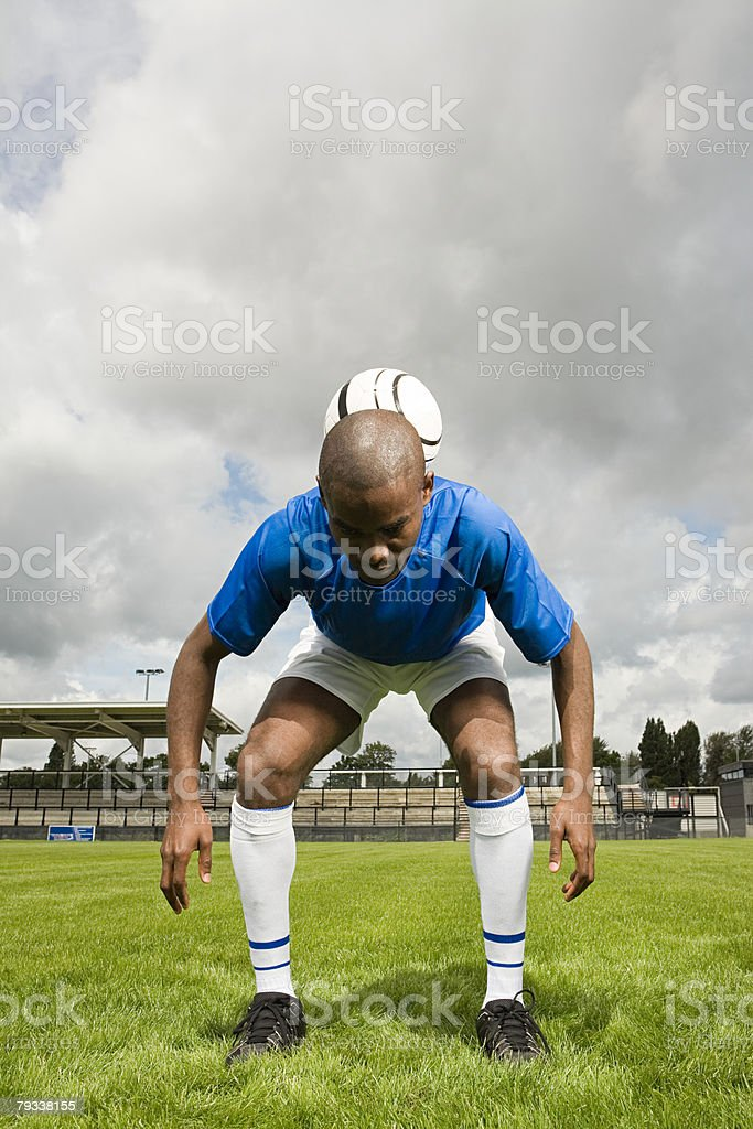 A footballer performing tricks 免版稅 stock photo
