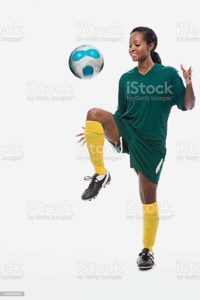 Footballer playing keepy uppy stock photo