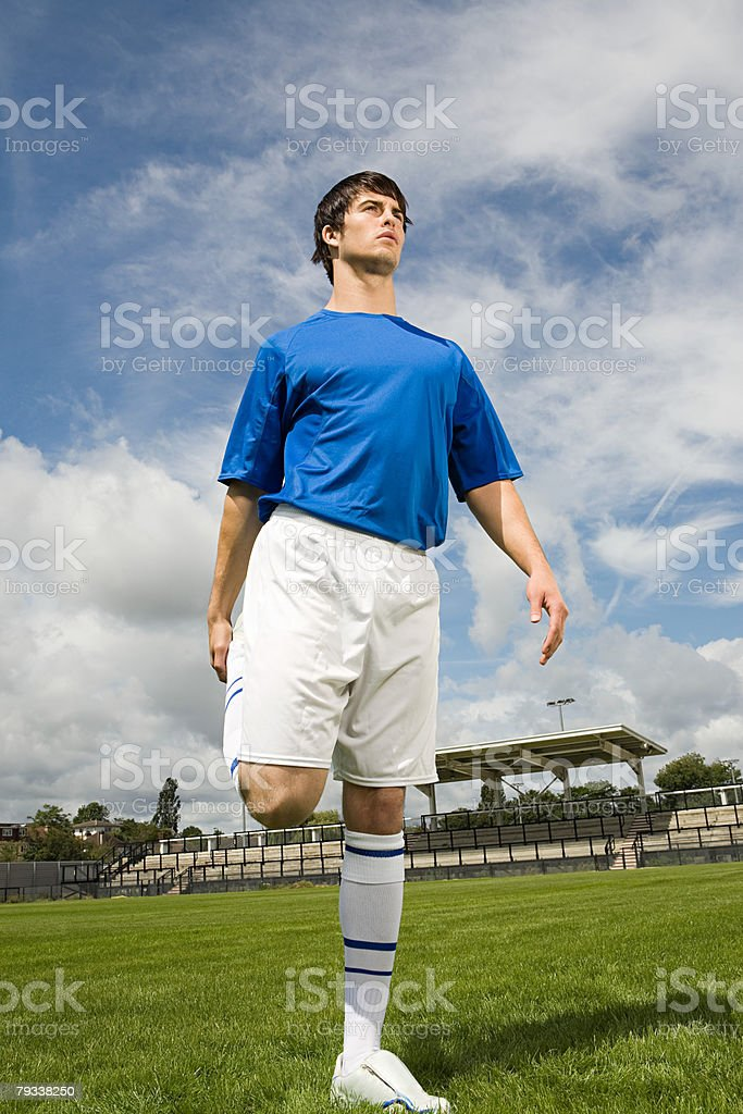 A footballer stretching royalty-free stock photo