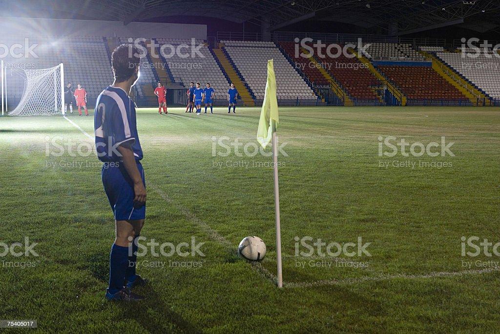 Footballer taking a corner kick stock photo