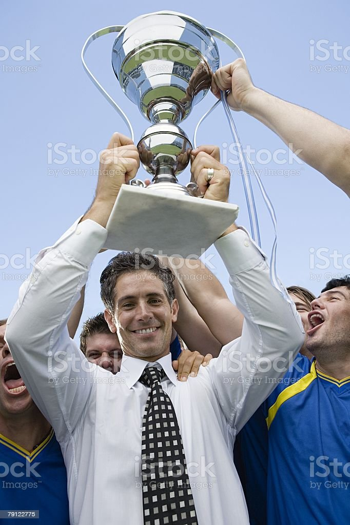 Footballers holding a trophy 免版稅 stock photo