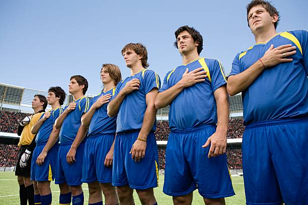 footballers in a row - national anthem stock photos and pictures
