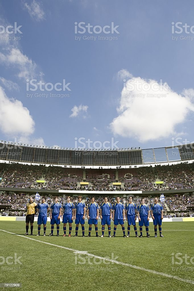 Footballers in a row 免版稅 stock photo