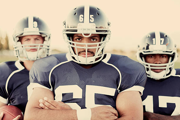 Footballers These American Football Players are ready to pound it into the endzone. football lineman stock pictures, royalty-free photos & images
