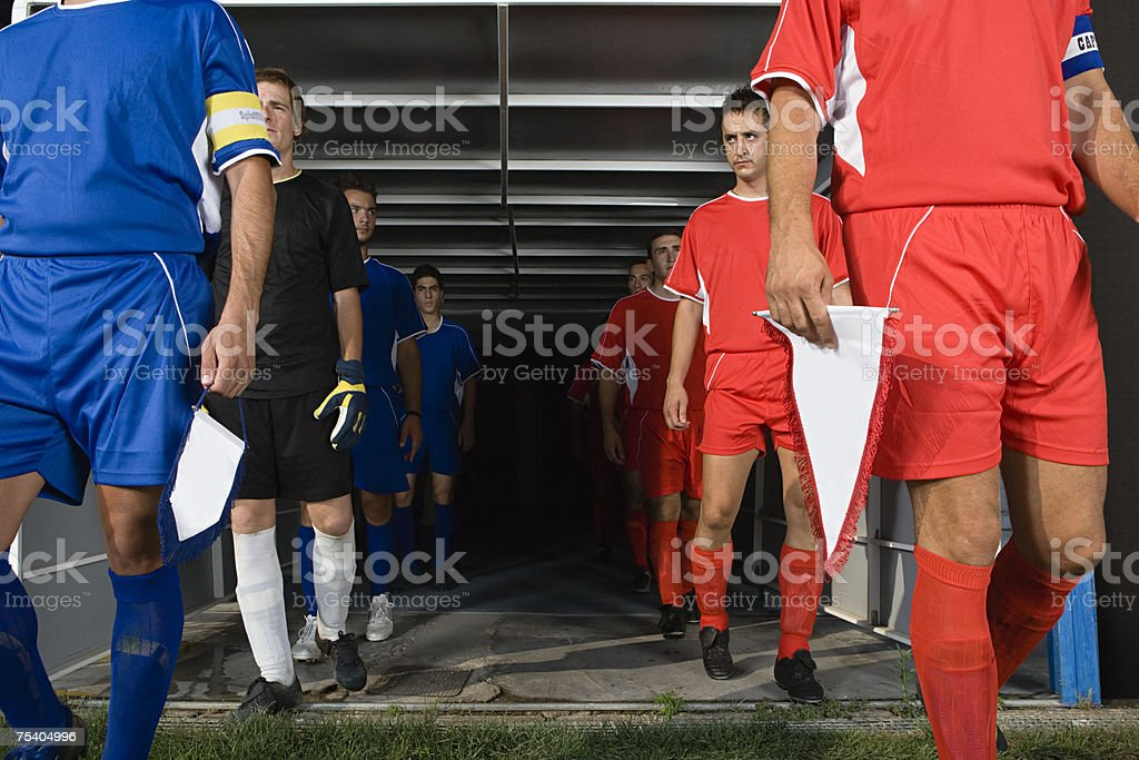 Footballers walking out of tunnel foto de stock royalty-free