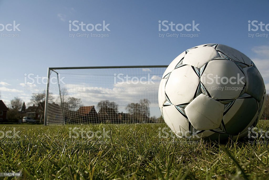Footballl on the grass in front of a big goal royalty-free stock photo