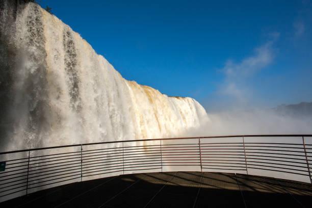 Footbridge and waterfalls in Iguazu National park stock photo