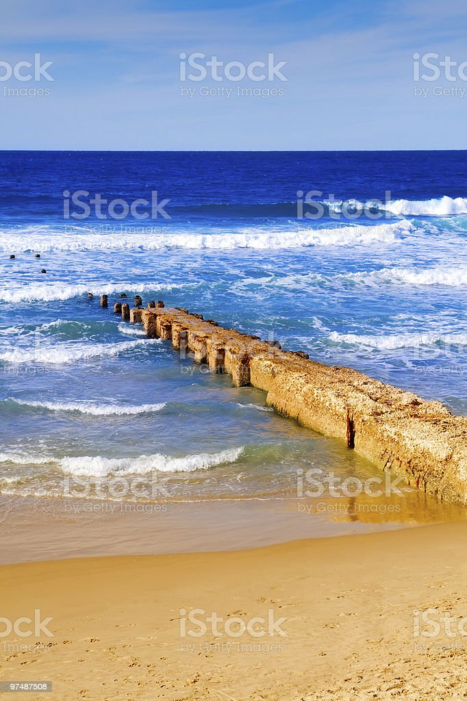 Footbridge at sandy seashore royalty-free stock photo