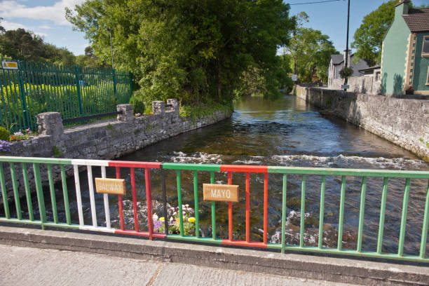 Footbridge over River Cong, Cong Village on the  County Mayo/Galway border, Ireland stock photo