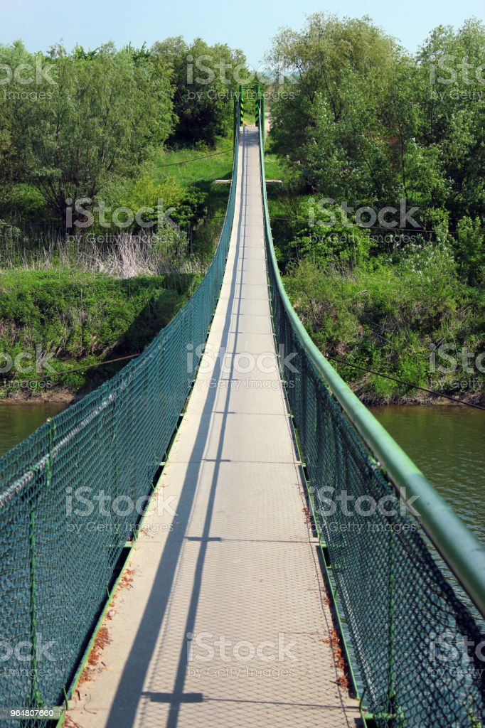 Footbridge over San river on Green Velo bicycle route, the longest consistently marked cycle trail in Eastern Poland. royalty-free stock photo