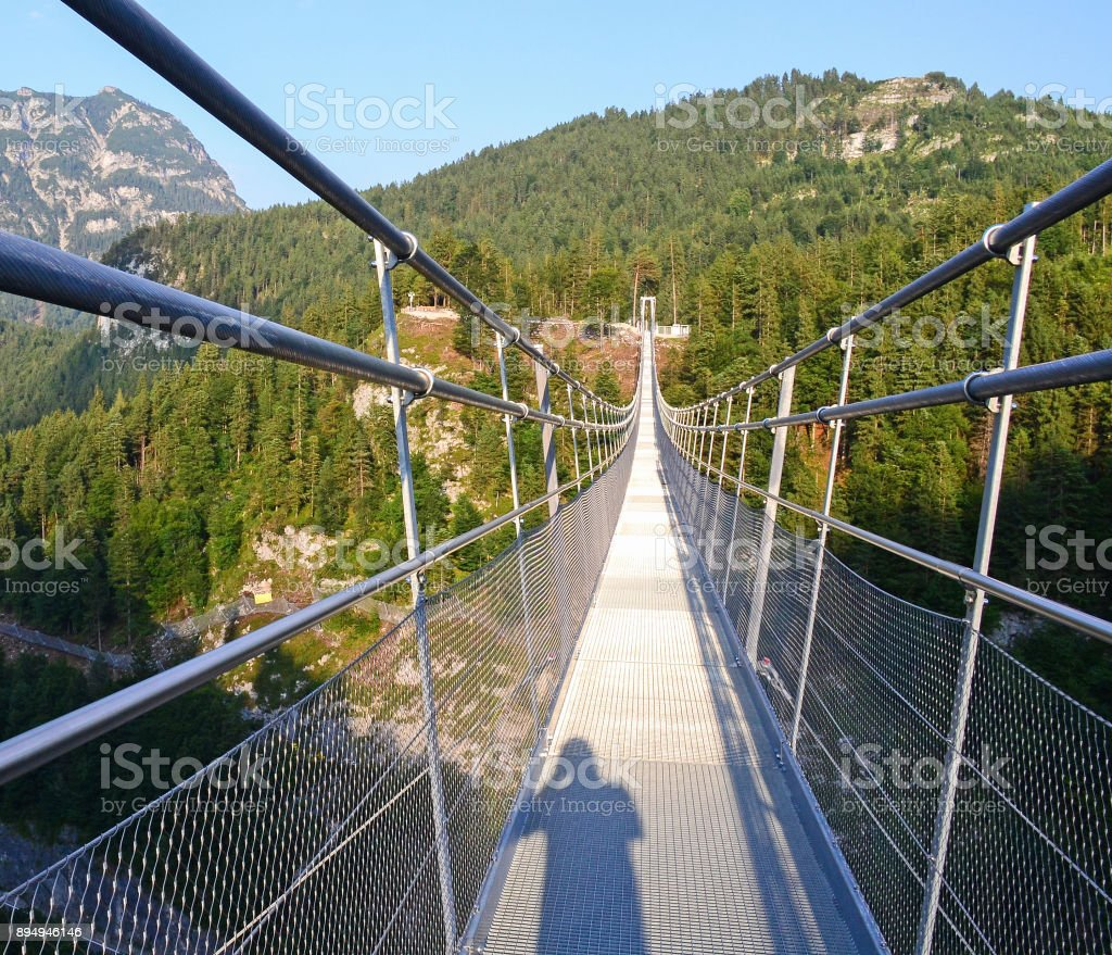 Footbridge over the valley in Austria stock photo