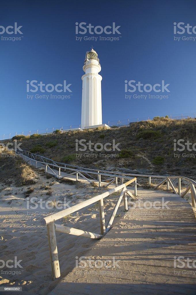 footbridge to lighthouse royalty-free stock photo