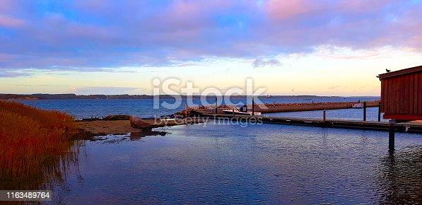 Floating fishing ship in lake with footbridge