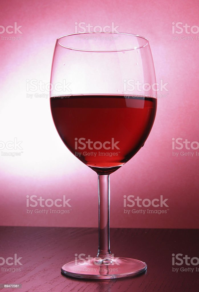 Footed glass of red wine royalty-free stock photo