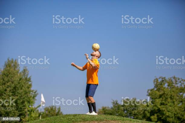 Footgolf player heading the ball picture id858486440?b=1&k=6&m=858486440&s=612x612&h=odtgssdc7xksvghh9 hwgo0zicnebus7esul2djerzs=