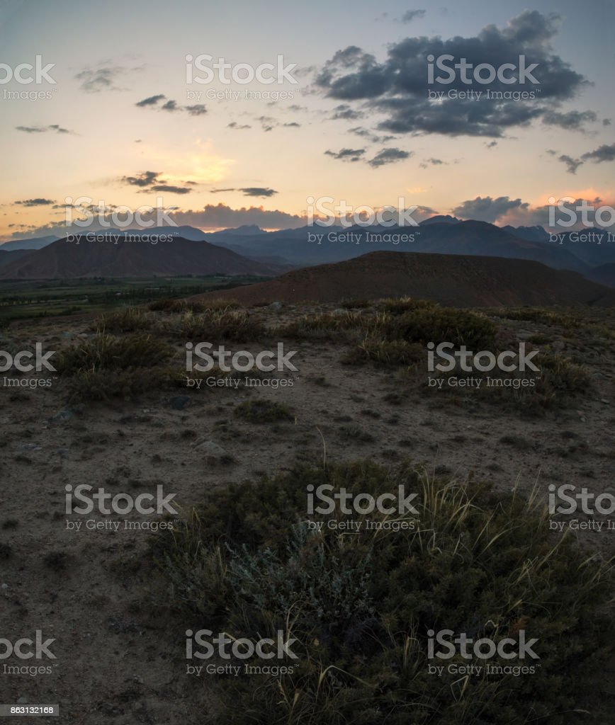 foothills at sunset, mountain ranges of Kyrgyzstan stock photo