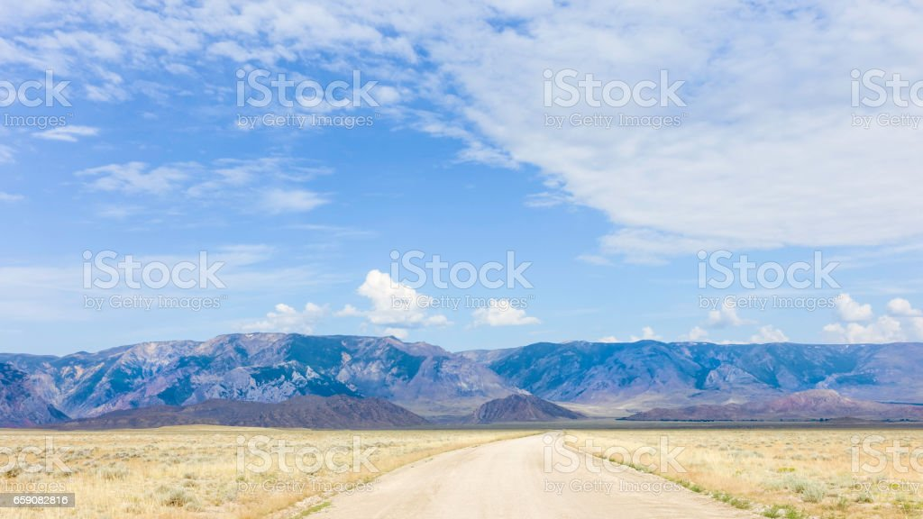Foothills of Bear Tooth mountans and arid prairie,  Montana, USA. stock photo