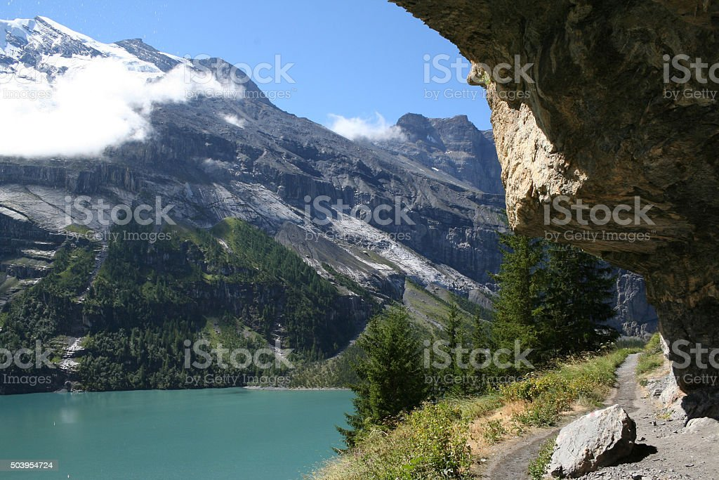 Footpath along Lake Oeschinensee in the Swiss Alps stock photo