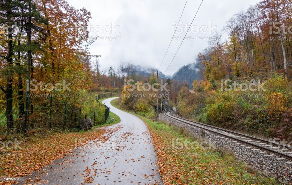 Footpath along railway with nobody during colorful autumn season in Austria. stock photo
