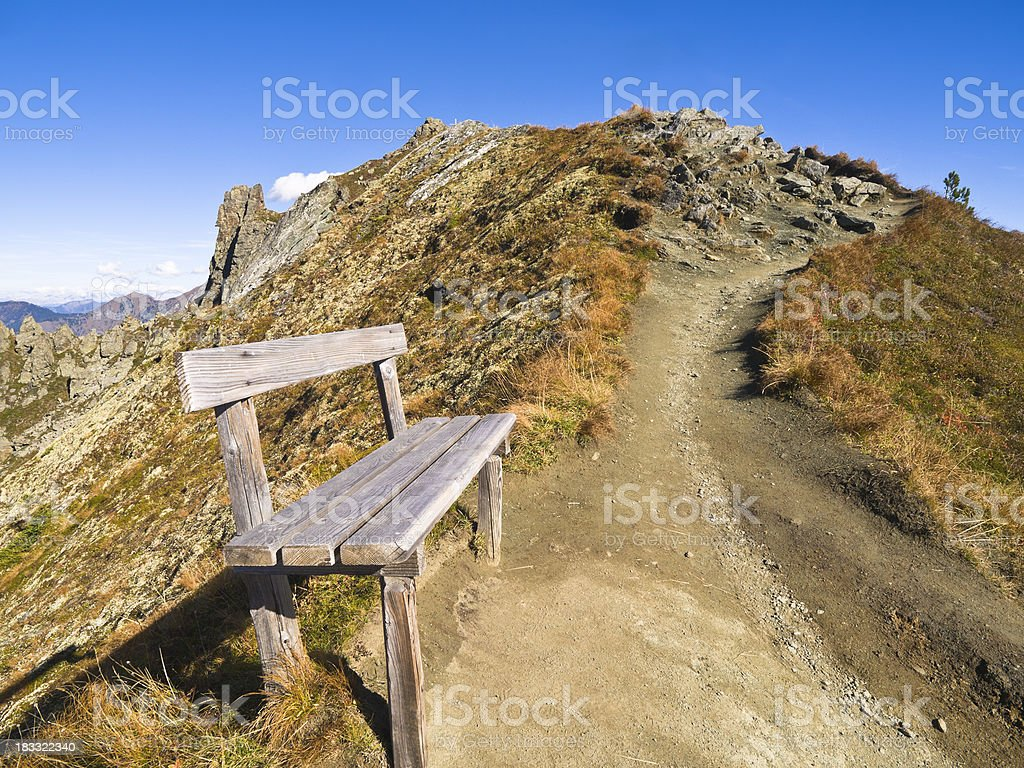 A footpath and bench on a mountain royalty-free stock photo