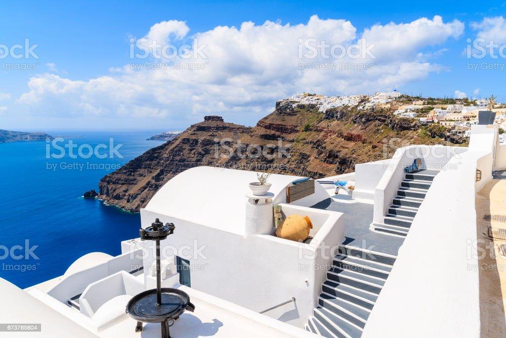 Footpath in Firostefani village with view of caldera and sea, Santorini island, Greece stock photo