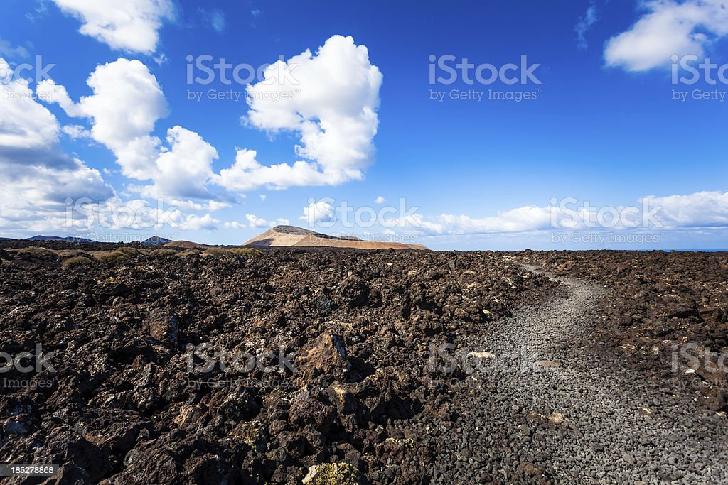 Footpath in Volcanic Landscape, Lanzarote, Canary Islands royalty-free stock photo