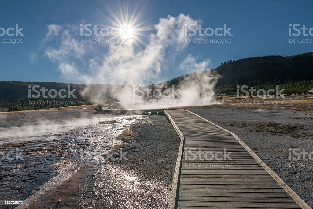 Footpath leading through Biscuit Basin, Yellowstone National Park, USA stock photo