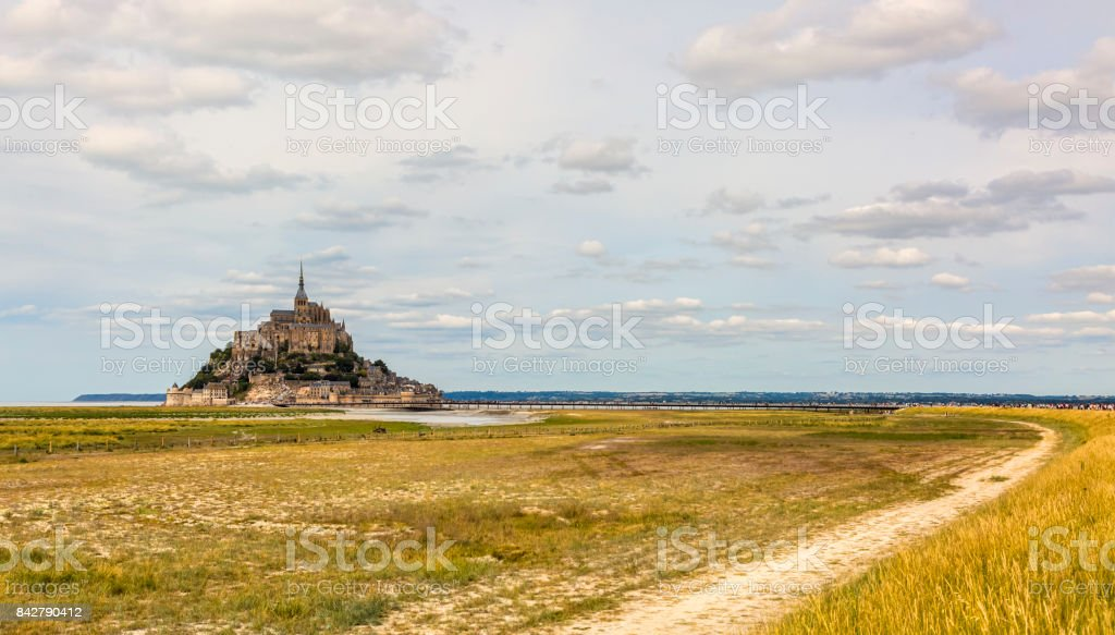 Footpath Leading to the Famous Mont Saint Michel Abbey stock photo