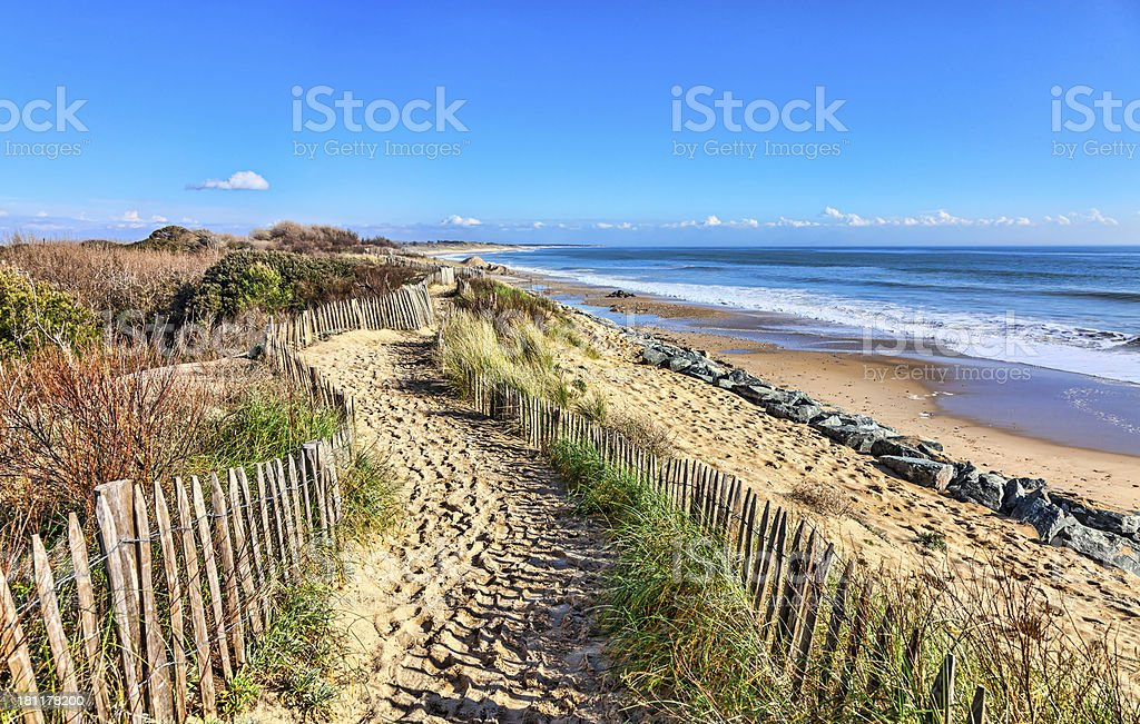 Footpath on the Atlantic Dune in Brittany Footpath between wooden fences on the Atlantic Dune in Brittany, in north-west of France. Atlantic Ocean Stock Photo