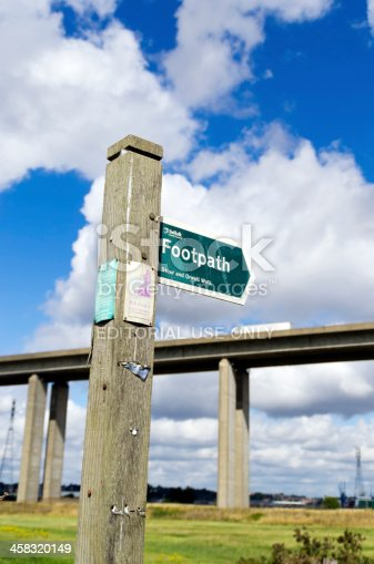 Ipswich, England - August 30, 2013: A footpath sign near the Orwell Bridge at Wherstead, just outside Ipswich, in Suffolk, England, on a sunny August day.