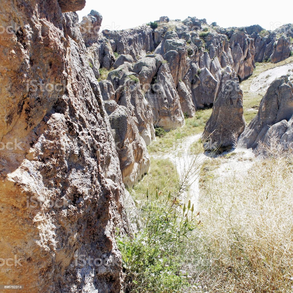 Footpath through the rugged mountains and rocks of Cappodocia in the heart of Anatolia, Turkey stock photo