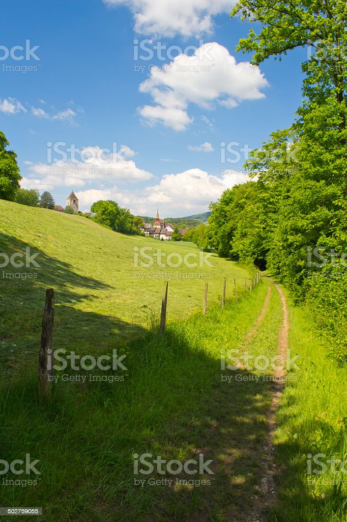 Footpath to the village stock photo