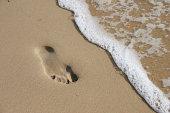 a footprint near the sea