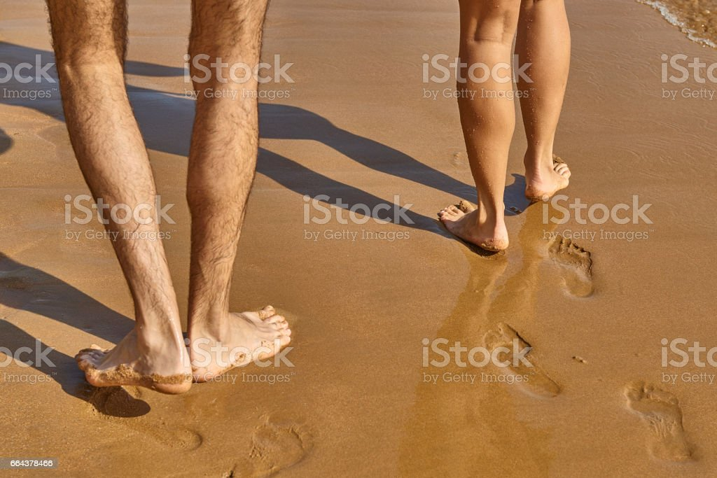Footprint on the beach with sea wave background stock photo