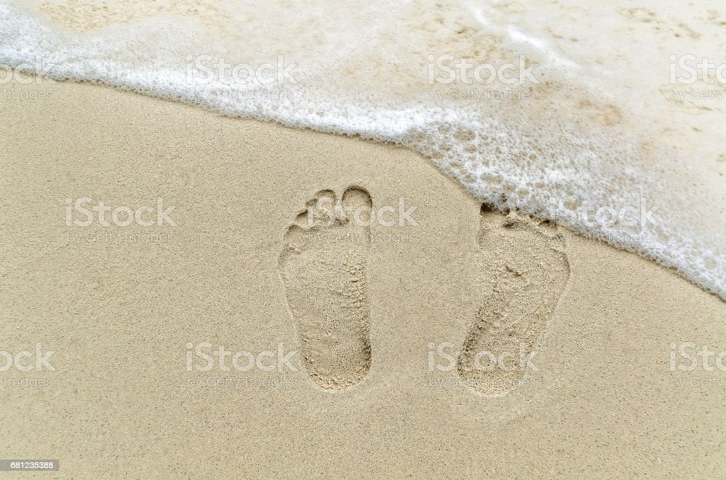 Footprint on the sand stock photo