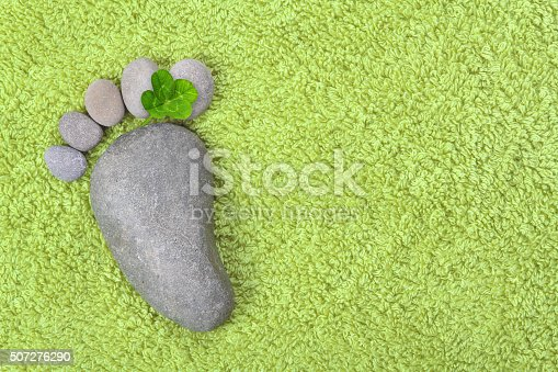 istock Footprint with four-leaf clover 507276290