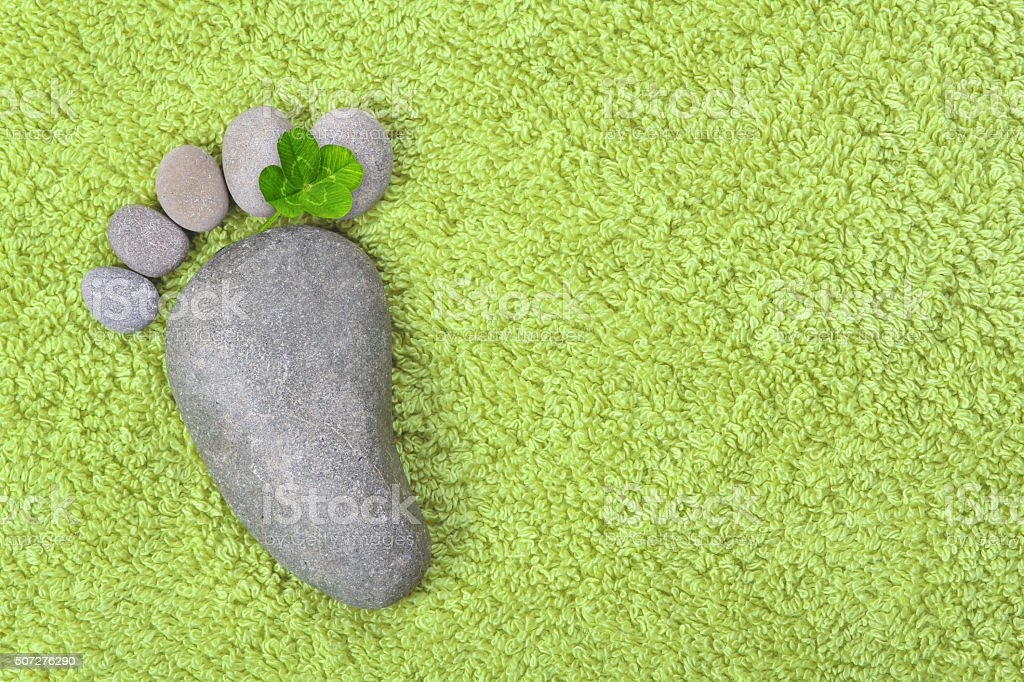 Footprint with four-leaf clover stock photo