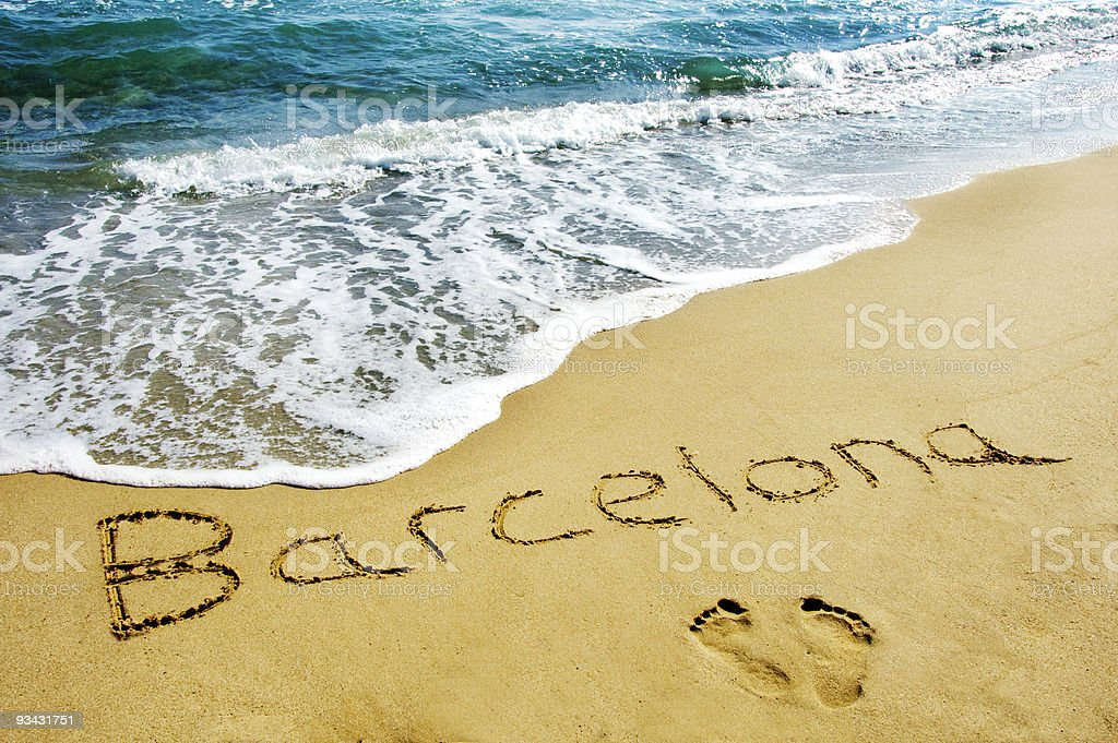 Footprints and Barcelona writing in sand on beach royalty-free stock photo