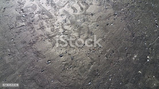 istock Footprints in Gold Sand 523053328