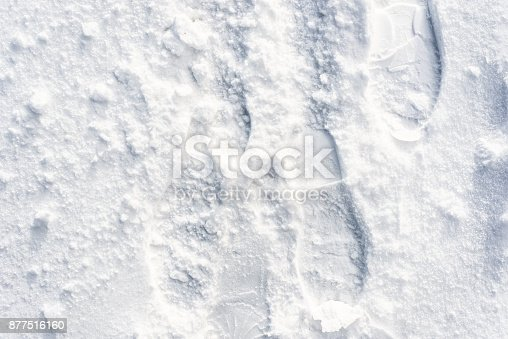 629589448 istock photo Footprints in snow, winter texture for design background 877516160