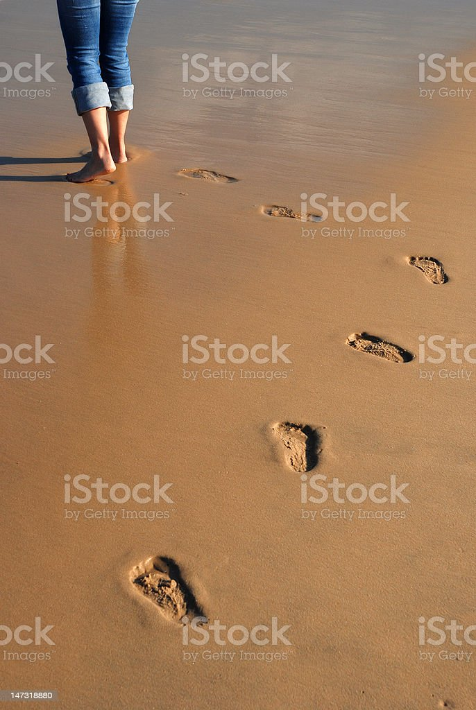 Footprints in the beach royalty-free stock photo
