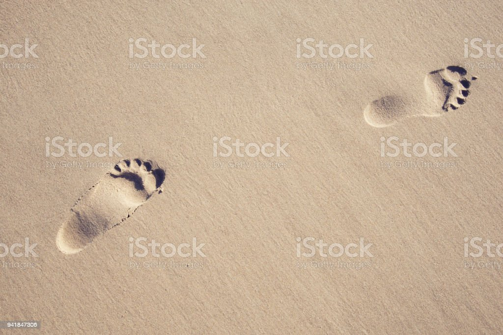Footprints in the sand at the sea stock photo