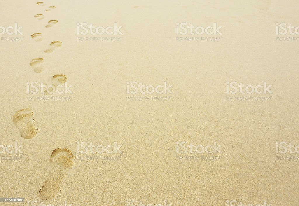footprints in the sand background stock photo