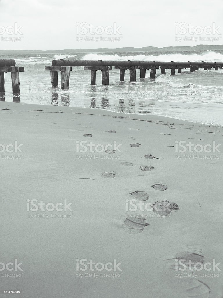 Footprints in the sand - B+W royalty-free stock photo