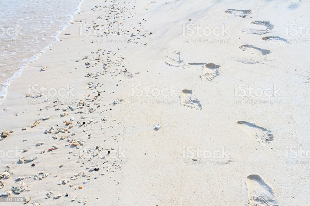 Footprints in the sand on beach stock photo