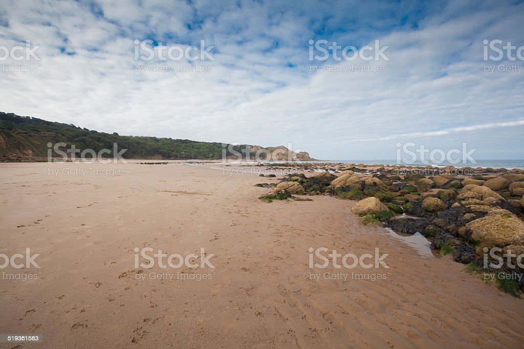 Footprints in the sand seascape stock photo